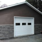 garage avec insertion de pierre